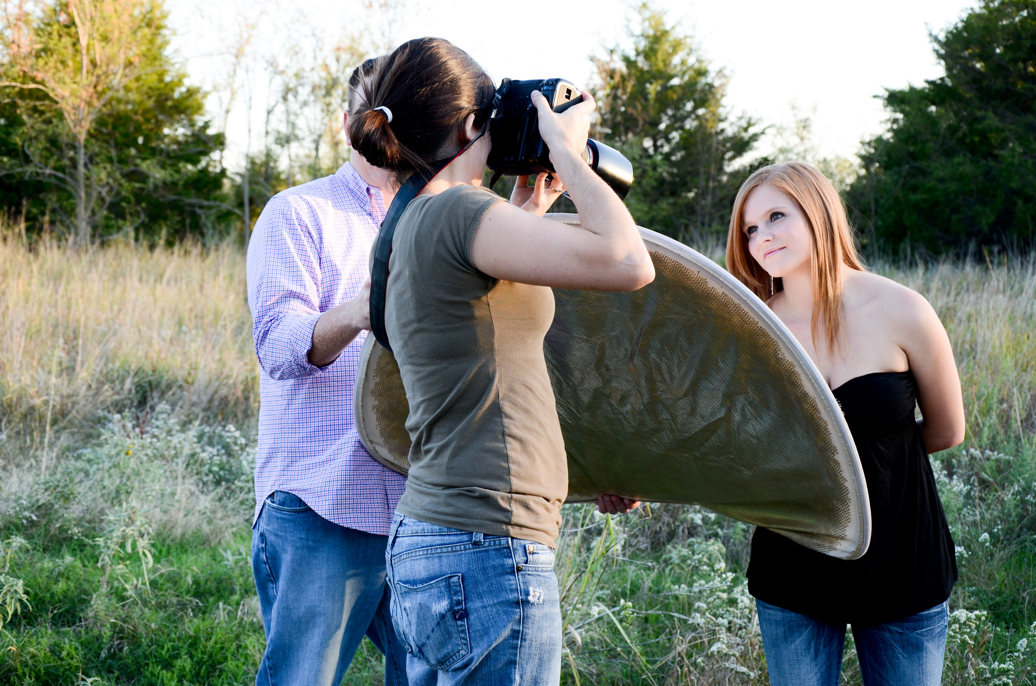 Photographer using reflector for high school senior | Mullica Hill, NJ